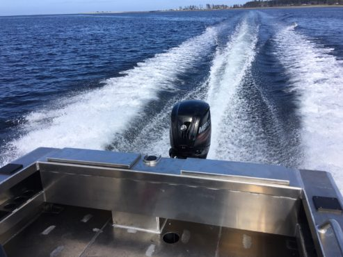 Outboard motor on the water