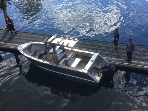 Docked boat with centre console